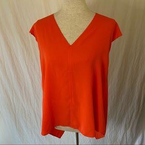 Orange swingy v-neck top M
